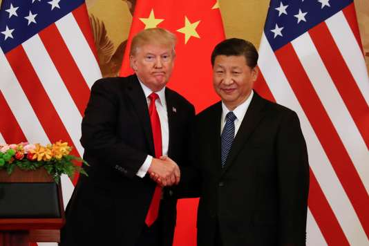 U.S. President Donald Trump and China's President Xi Jinping shake hands after making joint statements at the Great Hall of the People in Beijing